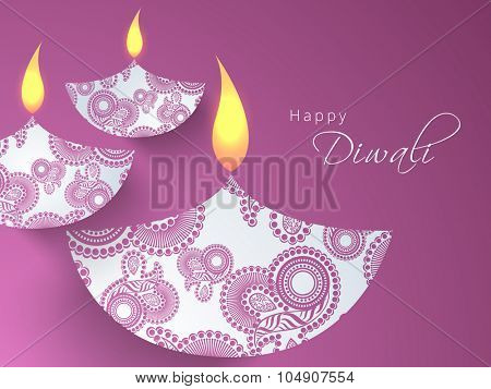 Glossy floral decorated illuminated lit lamps on purple background for Indian Festival of Lights, Happy Diwali celebration.