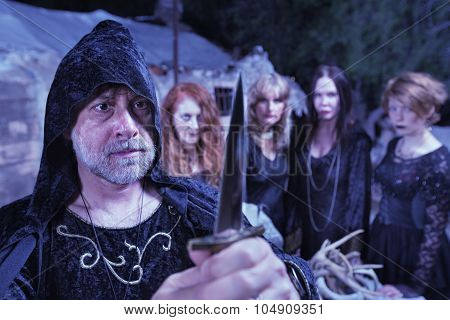 Priest With Witch Coven And Dagger