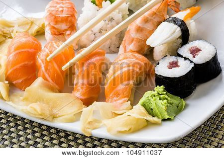 Close Up Of Sushi Plate Of - Japanese Food With Maki Nigiri Rolls And Wasabi