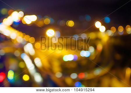 defocus of street neon light in the modern city at night