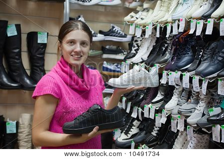 Woman Chooses Sporty Shoes