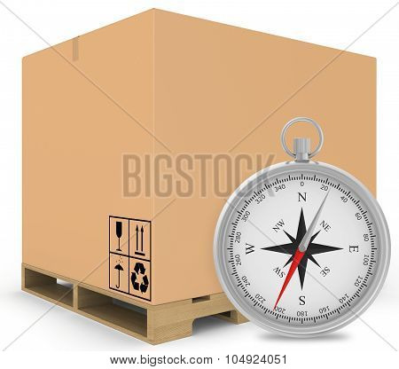 Paper covered boxes on wooden pallet with a compass standing next