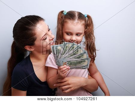 Happy Casual Family Holding Dollars And Thinking How To Spend The Money. Portrait