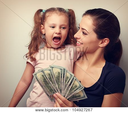 Happy Smiling Family Holding Dollars And Thinking How To Spend The Money. Vintage