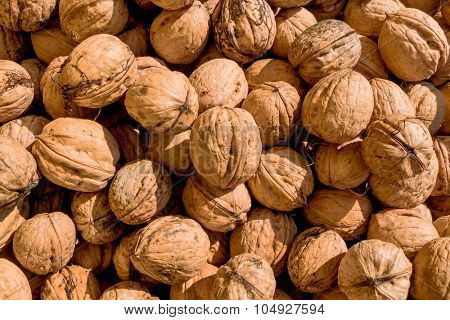 many walnuts close-up, solve symbol of problems, fullness, hardness