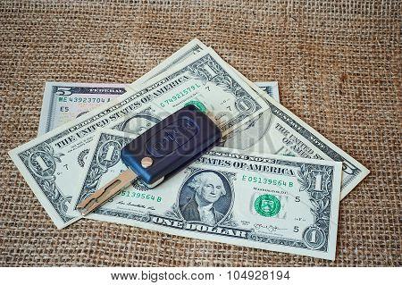 Money And Car Keys On A Burlap