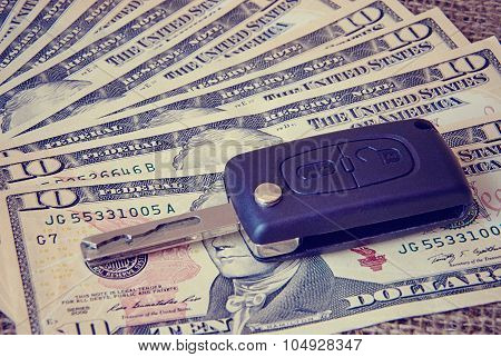 Money And Car Keys On A Burlap Background