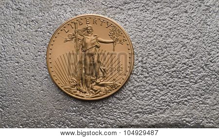American Gold Eagle Coin On Silver Bar