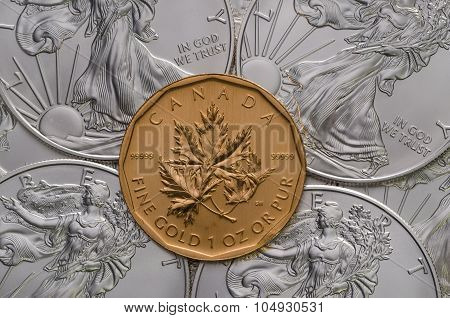 Canadian Gold Maple Leaf Ontop Of American Silver Eagles