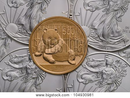 Chinese Gold Panda Ontop Of Us Silver Eagles