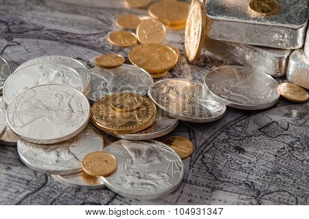 Gold & Silver Coins With Silver Bars On Map