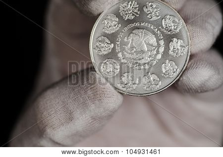 Mexican Libertad Silver Coin Hand Held