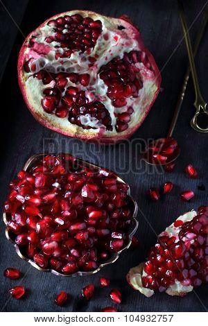 Pomegranate On A Dark Background