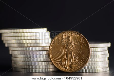 United States Gold Eagle Coin Saint-gaudens Infront Silver Coins