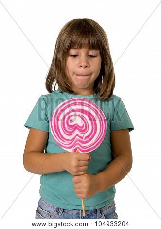 4 Or 5 Years Old Child Girl Eating Big Pink Lollipop Candy Isolated On White Background