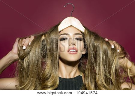 Portrait Of Pretty Woman With Hanger In Hair