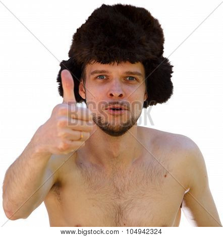 Nude Man In Fur Hat Shows Thumb