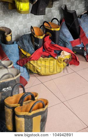 High angle view of firefighter's shoes on tiled floor at fire station