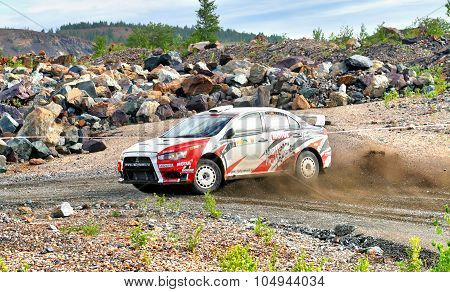 BAKAL, RUSSIA - JULY 21: Gennadiy Broslavskiy's Mitsubishi Lancer Evo X (No. 2) competes at the annual Rally Southern Ural on July 21, 2012 in Bakal, Satka district, Chelyabinsk region, Russia.