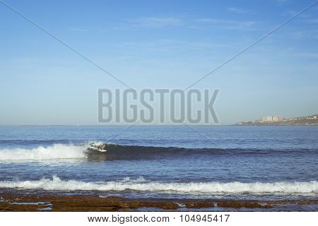 A Man Riding The Waves On The Surf