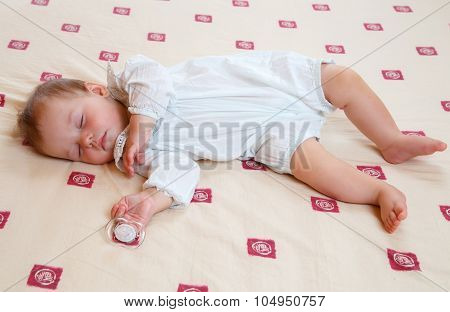 Adorable Sleeping Baby With Dummy In His Hand