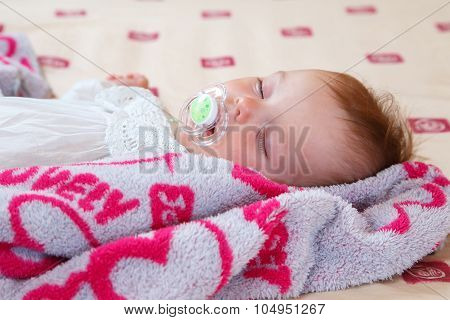Sweet Sleeping Baby With Soother