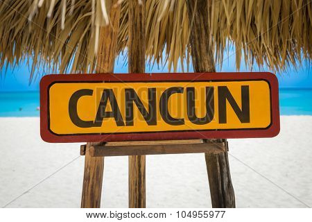 Cancun sign with beach background