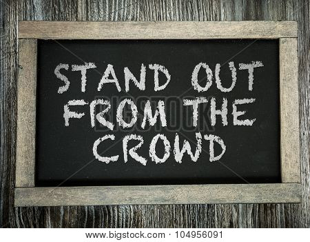 Stand Out From the Crowd written on chalkboard