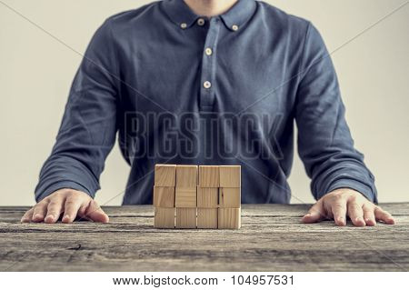 Retro Image Of Businessman, Student Or Engineer Sitting At His Desk Looking At Structure Made Of 16