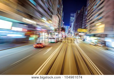 Blurry motion effect night city view from car perspective in Hong Kong downtown