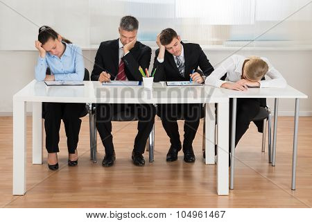 Businesspeople Getting Bored While Working In Office