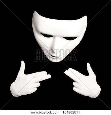 Pantomime. White theatrical mask isolated on black