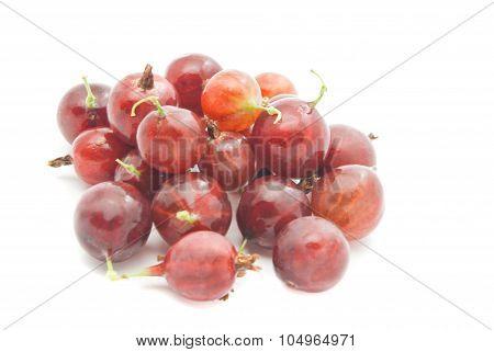 Heap Of Red Gooseberries On White