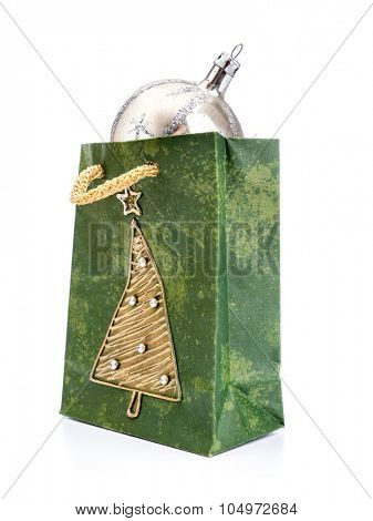Green paper christmas shopping bag with silver christmas ball shot on white background