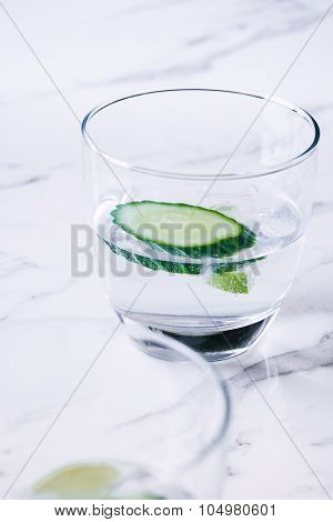 gin and tonic with lime and cucumber