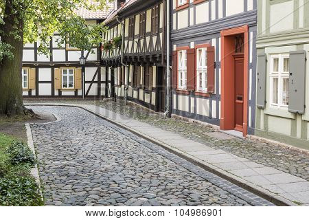 Historic alleyway with half-timbered houses