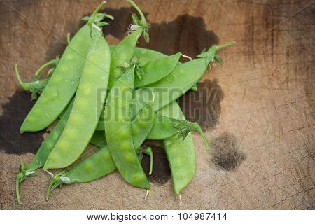 Snow Peas On A Wooden Chop Board