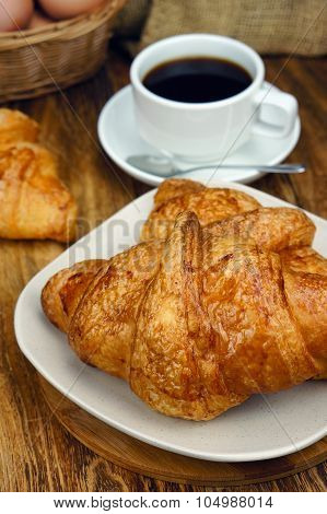 Croissant Ready For Breakfast On Wooden Table