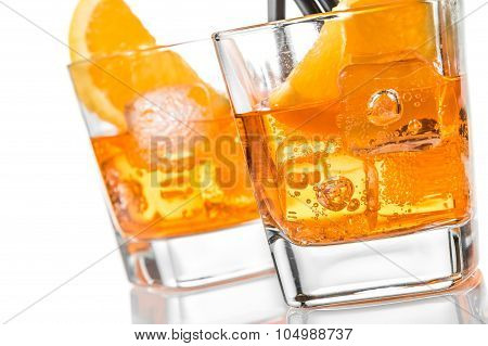 Detail Of Two Glasses Of Spritz Aperitif Aperol Cocktail With Orange Slices And Ice Cubes