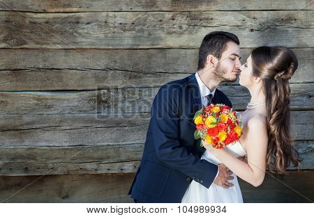 In Love Bride And Groom On Wodden Background