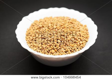Organic Fenugreek in white bowl.