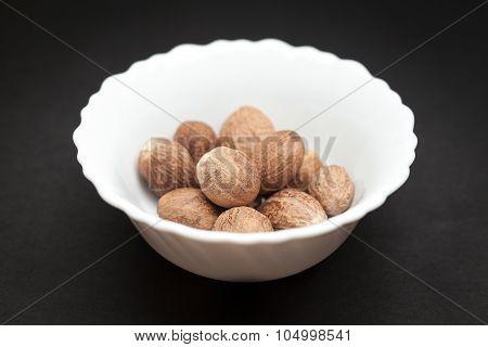 Organic Nutmeg Seed in white bowl.