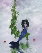 stock photo of nymphet  - Mermaid sitting on a vined moon above water - JPG