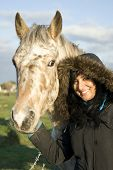 stock photo of appaloosa  - Color portrait photo of a Beautiful asian woman with appaloosa horse - JPG