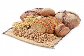 foto of fresh slice bread  - fresh sliced bread  and wheat on wooden board isolated on white - JPG