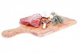 picture of peppercorns  - raw beef meat fillet with peppercorn and thyme ready to grill on wood board isolated over white background - JPG
