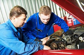 image of combustion  - two motor mechanic engineers examining timing belt and internal combustion engine of automobile car at repair service station - JPG