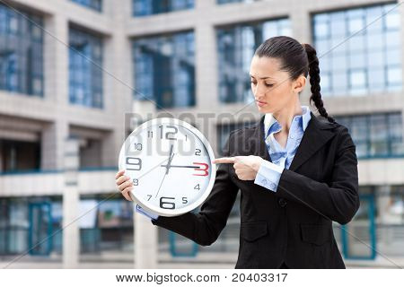 Business Woman Holding Analog Clock