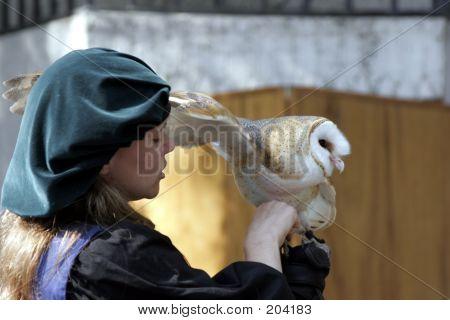 Trainer Holding An Eastern Screech Owl