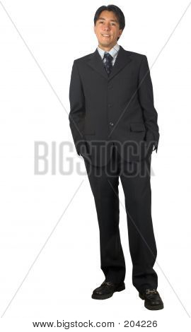 Business Man Standing - Hands In Pockets